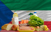 Basic food groceries in front of equatorial guinea national flag — Stock Photo