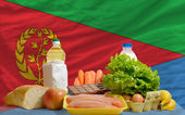 Basic food groceries in front of eritrea national flag — Stock Photo