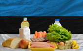Basic food groceries in front of estonia national flag — Stock Photo