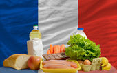 Basic food groceries in front of france national flag — Stock Photo