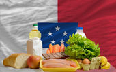 Basic food groceries in front of franceville national flag — Stock Photo