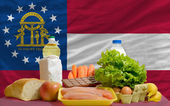 Basic food groceries in front of georgia us state flag — Stock Photo