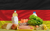 Basic food groceries in front of germany national flag — Stock Photo