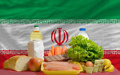 Basic food groceries in front of iran national flag — Stock Photo