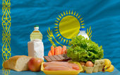 Basic food groceries in front of kazakhstan national flag — Stock Photo