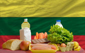 Basic food groceries in front of lithuania national flag — Stock Photo