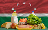 Basic food groceries in front of maghreb national flag — Stock Photo