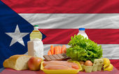 Basic food groceries in front of puertorico national flag — Stock Photo
