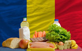 Basic food groceries in front of romania national flag — Stock Photo