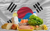 Basic food groceries in front of south korea national flag — Stock Photo