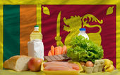 Basic food groceries in front of sri lanka national flag — Stock Photo