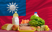 Basic food groceries in front of taiwan national flag — Stock Photo