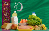 Basic food groceries in front of turkmenistan national flag — Stock Photo