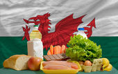 Basic food groceries in front of wales national flag — Stock Photo