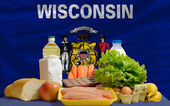 Basic food groceries in front of wisconsin us state flag — Stock Photo