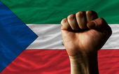 Hard fist in front of equatiorial guinea flag symbolizing power — Stock Photo