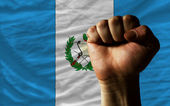 Hard fist in front of guatemala flag symbolizing power — Stock Photo