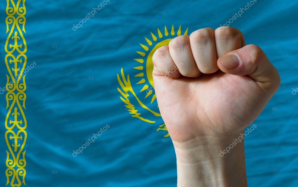 Complete national flag of kosovo covers whole frame, waved, crunched and very natural looking. In front plan is clenched fist symbolizing determination — Stockfoto #11039298