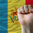 Hard fist in front of moldova flag symbolizing power — Stock Photo