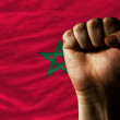 Hard fist in front of morocco flag symbolizing power — Stock Photo