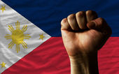 Hard fist in front of philippines flag symbolizing power — Stock Photo