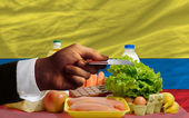 Buying groceries with credit card in colombia — Stock Photo