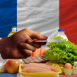 Buying groceries with credit card in france — Stock Photo #11181416