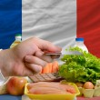 Buying groceries with credit card in france — Stock Photo