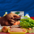 Buying groceries with credit card in haiti — Stock Photo