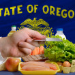 Buying groceries with credit card in us state of oregon - Stock Photo
