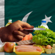Buying groceries with credit card in pakistan - Stock Photo