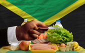 Buying groceries with credit card in jamaica — Stock Photo