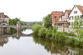Historic city in germany with river and stone bridge — Stock Photo