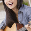 Beautiful Happy Chinese Oriental Asian Woman Smiling & Guitar — Stock Photo