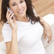 Woman Talking on Mobile Cell Phone At Home — Stock Photo
