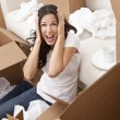 Royalty-Free Stock Photo: Woman Screaming Unpacking Boxes Moving House