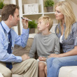 Male Doctor Home Visit Examining Boy Child With Mother — Stockfoto