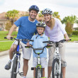 Young Family Parents and Boy Son Cycling — Stock Photo #11060056