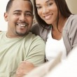 Happy African American Couple Sitting At Home — Stock Photo
