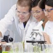 Interracial Team of Scientists In Laboratory With Laptop — Stock Photo