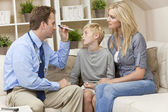 Male Doctor Home Visit Examining Boy Child With Mother — Stock Photo