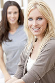 Two Young Women Friends At Home on Sofa — Stock Photo