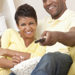 African American Couple Eating Popcorn Watching Television — Stock Photo
