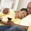 Happy African American Man & Woman Couple Drinking Wine — Stock Photo #11457495