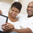 African American Man Woman Couple Using Tablet Computer — Stock Photo