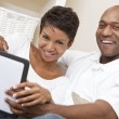 Royalty-Free Stock Photo: African American Man Woman Couple Using Tablet Computer
