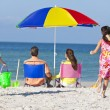 Stock Photo: Mother Father Daughter Son Parents Children Family on Beach