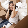Woman Screaming Unpacking Boxes Moving House - Stock Photo