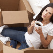 Woman Drinking Coffee Unpacking Boxes Moving House — Stock Photo #11457879