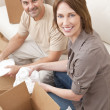 Happy Couple Unpacking or Packing Boxes Moving House — Stock Photo